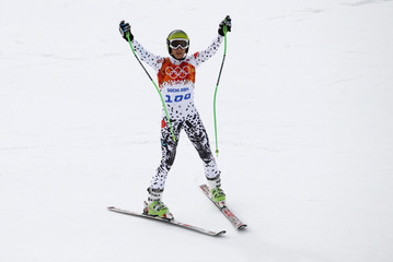 Peru's Manfred Oettl Reyes reacts after the first run of the men's alpine skiing giant slalom event in the Sochi 2014 Winter Olympics at the Rosa Khutor Alpine Center