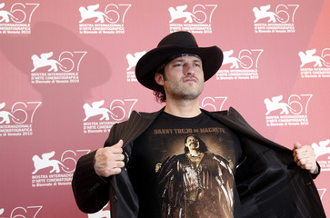 "Director Rodriguez poses for photographers during the ""Machete"" photocall at the 67th Venice Film Festival"