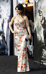"""Gugino poses at the premiere of """"Sucker Punch"""" at the Grauman's Chinese theatre in Hollywood"""