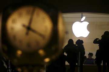 The Apple logo is pictured behind the clock at Grand Central Terminal in the Manhattan borough of New York