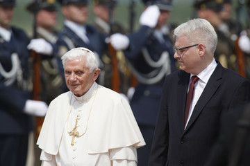 Pope Benedict XVI is accompanied on arrival by Croatian President Ivo Josipovic at Pleso International Airport in Zagreb