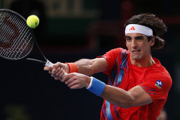 Bellucci of Brazil returns the ball to Anderson of South Africa during the Paris Masters tennis tournament in Paris