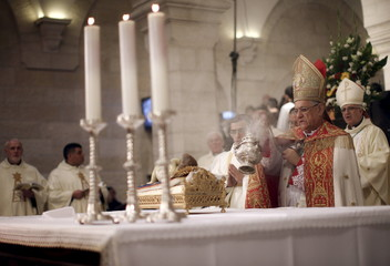 Latin Patriarch of Jerusalem Fouad Twal leads a Christmas midnight mass at the Church of the Nativity in the West Bank town of Bethlehem