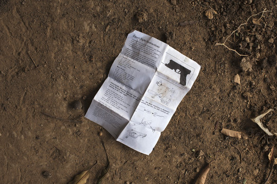 A manual for installing laser sight on gun lies in the courtyard of local resident Issa Dembele's house in Diabaly
