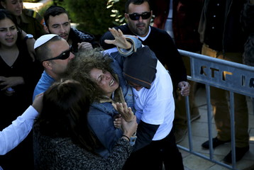 The mother of Israeli soldier Ziv Mizrahi mourns during his funeral at Mount Herzl military cemetery in Jerusalem