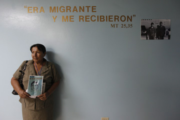 Elvira Alvarado, 58, holds a picture of her cousin Ana Aguilar, an illegal immigrant who went missing in 1995, after a mass conducted in memory of missing Honduran immigrants in Tegucigalpa