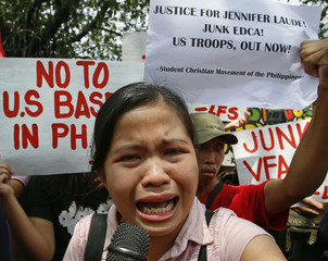 A student cries as she speaks during a protest rally against the killing of Laude, outside the U.S. embassy in Manila