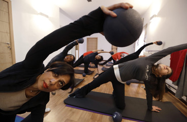 Pilates instructor Zainab Abbas leads a class at her fitness studio in Lahore