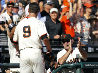 Giants manager Bochy applauds after Burrell scored against the Phillies during Game 3 of their Major League Baseball NLCS playoff series in San Francisco