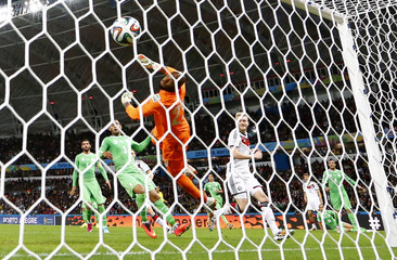 Germany's Andre Schuerrle scores past Algeria's goalkeeper Rais Mbolhi during their 2014 World Cup round of 16 game at the Beira Rio stadium