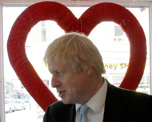 London's Mayor Boris Johnson is silhouetted by a heart shape as he visits a business whilst campaigning for the local Conservative candidate in Finchley, north London