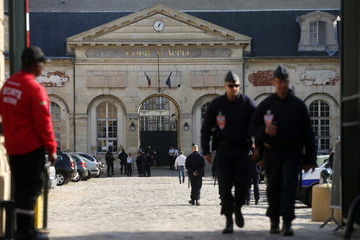 Police officers secure the entrance of the Appeal Court of Versailles for the arrival of vehicles transporting Mehdi Nemmouche, 29, the French national who is suspected of the shooting attack in the Brussels Jewish Museum last month,