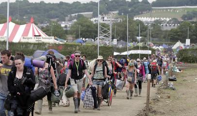 Festival goers leave Worthy Farm and the Glastonbury Festival, Somerset