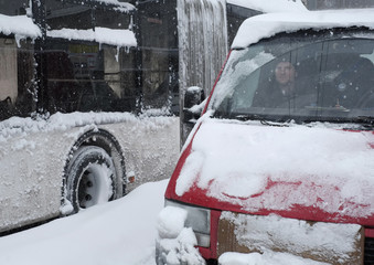 A driver waits in a car that is stuck in snow during a blizzard in Ukrainian capital Kiev
