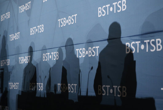 Silhouettes of Transportation Safety Board of Canada (TSB) members are pictured during a news conference at the Lac-Megantic Golf Club in Lac-Megantic