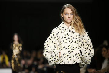 A model presents a creation by British-born designer Clare Waight Keller from her Fall/Winter 2014-2015 women's ready-to-wear collection show for French fashion house Chloe during Paris Fashion Week