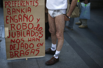 A man, who is affected by a fall in the prices of preference shares of Spanish lender bank Bankia,  wears panties as he protests in central Madrid