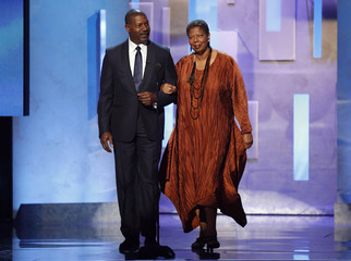 Dennis Haysbert and Lorraine C. Miller walk on stage to present the Hall of Fame Award during the 45th NAACP Image Awards in Pasadena