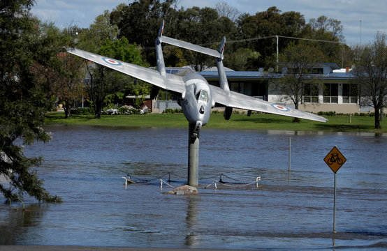 An Australian Air Force memorial lies submerged in the overflowing Lachlan River after heavy rain created a natural disaster zone being declared in the midwestern New South Wales town of Forbes, Australia