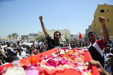 Mourners shout anti-government slogans during the funeral of Isa Abdul Ali Radhi in Sitra