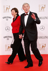 Former German president Koehler and his wife Eva walk on the red carpet during the Bambi 2016 media awards ceremony in Berlin