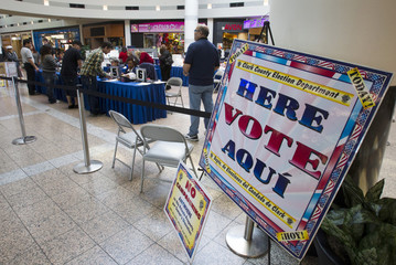 Voters sign in at an early voting location in the Boulevard Mall in Las Vegas