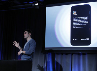 "Adam Mosseri, Facebook's director of product shows a live demonstration of ""Cover Feed"" on an Android phone in Menlo Park"