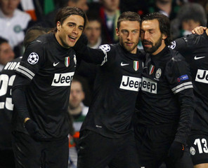 Juventus' Matri celebrates with his team mates Marchisio and Pirlo after they scored their first goal against Celtic during their Champions League soccer match at Celtic Park stadium in Glasgow, Scotland