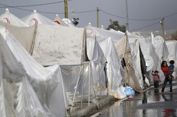 Syrian children stand next to their tents at the Boynuyogun refugee camp on the Turkish-Syrian border in Hatay province