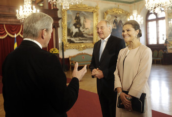 Sweden's Crown Princess Victoria and Latvia's President Berzins listen to a guide during their meeting in Riga