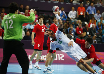Hungary's Laszlo Nagy makes his shot challenged by South Korea's Park Junggeu in their men's handball Preliminaries Group B match at the Copper Box venue during the London 2012 Olympic Games