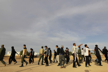 Trainees march as they take part in a training by rebel fighters in the town of Ar Rujban