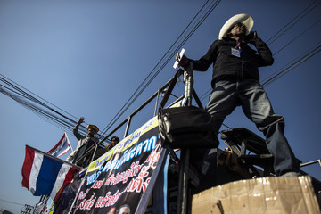 Anti-government protesters take part in a protest outside the Custom Department office in Bangkok