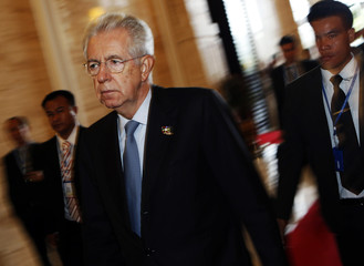 Italy's PM Monti arrives for a plenary session on the second day of the ASEM summit in Vientiane