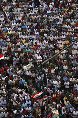 Supporters of the Muslim Brotherhood's presidential candidate Morsy pray during a celebration rally in Cairo