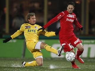 FC Thun's Schirinzi fights for the ball with FC Luzern's Lambert  during their Swiss Super League soccer match in Thun