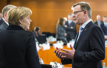 German Chancellor Merkel welcomes Thuringia's state premier Ramelow before a meeting of German state leaders at the chancellery in Berlin