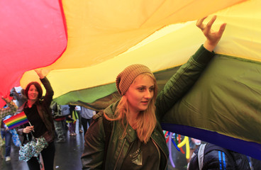 Participants hold a giant Rainbow flag as they march during the GayFest Parade in Bucharest