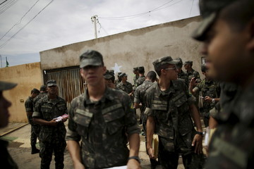 Brazilian soldiers conduct an inspection for the Aedes aegypti mosquito on a street of the Sao Sebastiao neighbourhood in Brasilia