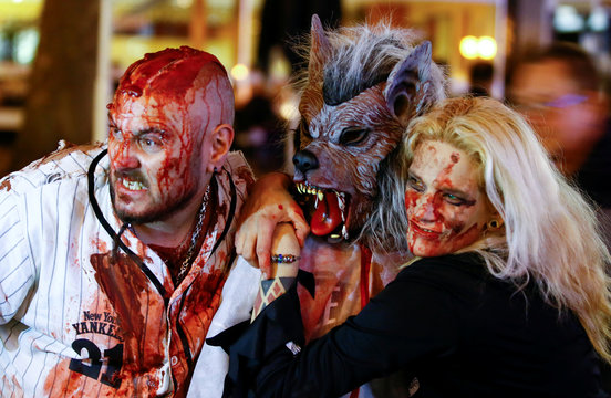 """Revellers pose for pictures during the so-called """"zombie walk"""" through the western German city of Essen on Halloween Day"""