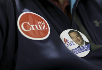 A supporter of U.S. Republican presidential candidate Senator Ted Cruz (R-TX) wears buttons during a campaign event Mount Pleasant