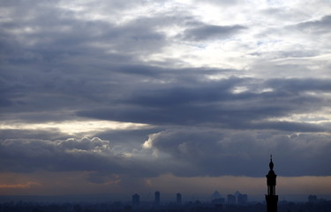 Cloudy skies are seen over houses, minarets and the Great Pyramids of Giza during the fifth anniversary of the uprising that ended the 30-year reign of Hosni Mubarak in Cairo