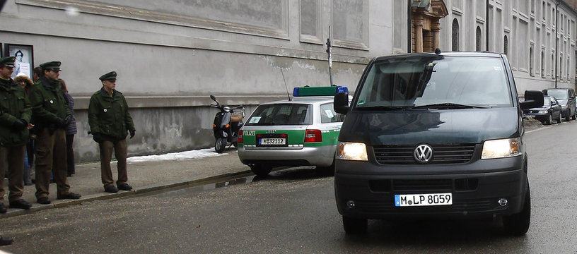 A police van with tinted windows carrying, according to a spokesperson of the Bavarian police, British boxer Dereck Chisora, arrives at Munich's main police station