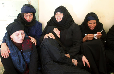 Relatives of Egyptian Coptic men killed in Libya mourn at their house in the south of Cairo