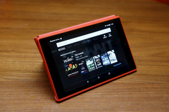 The new Amazon Fire HD 8 tablet in a case is displayed during a media event introducing new Amazon products in San Francisco