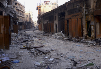 A view shows damaged buildings and shops in the old city of Aleppo