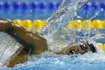 Dominican Republic's Schwab competes in the men's 200m freestyle heats at the 14th FINA World Championships in Shanghai