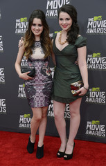 Actresses Laura and Vanessa Marano arrive at the 2013 MTV Movie Awards in Culver City