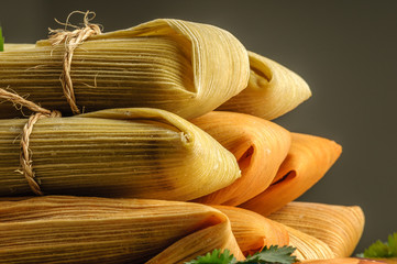 Mexican tamales made of corn and chicken isolated on white