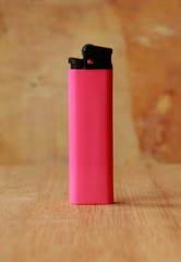 Lighter with natural stone background.